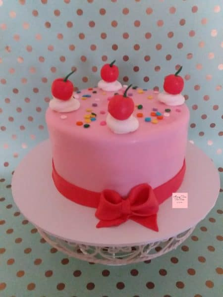 Fun Cake Birthday Celebration cherries on top pink fondant red bow and ribbon allergy free cake
